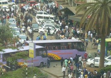 Nairobi CBD - pedestrians competing with buses and public service vehicles (Matatus)