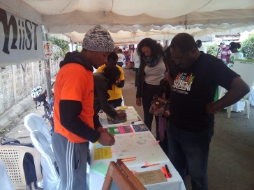 Residents talking to the i-CMiiST team during the Kiliman Street Festival