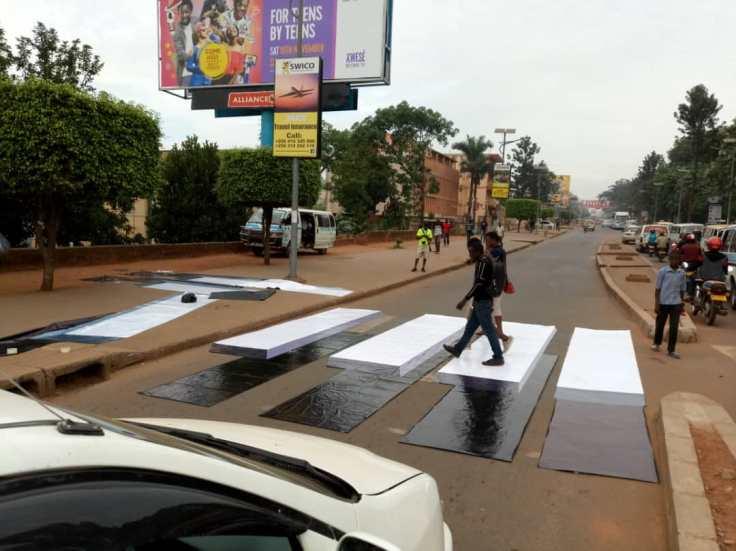 People cross on Bombo at a 3D zebra crossing